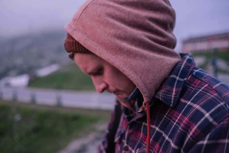 Young man in hood outdoors