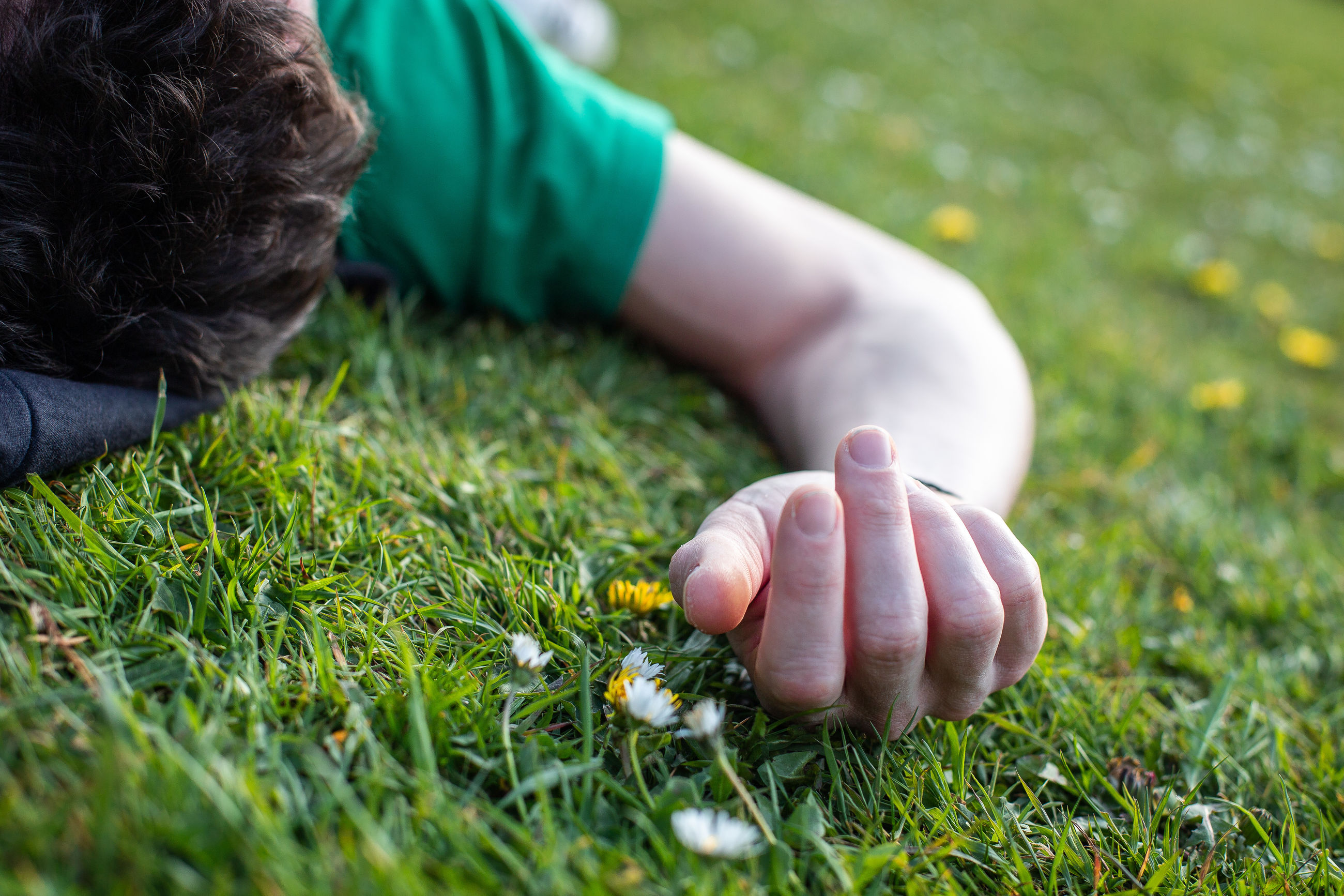 grass, plant, one person, green color, real people, field, human hand, child, childhood, nature, selective focus, hand, land, day, leisure activity, growth, close-up, human body part, holding, outdoors, finger, innocence