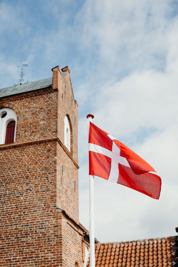 Photos taken during a wedding in Copenhagen, Denmark. Danish Flag Danish Denmark Scandinavia Scandinavian Church Nordic Light Northsea Summer Religion Tradition Building Exterior Built Structure Architecture Sky Flag Cloud - Sky Low Angle View Building Patriotism Red Day Nature No People Roof Outdoors Wall Pride Freedom National Icon Roof Tile