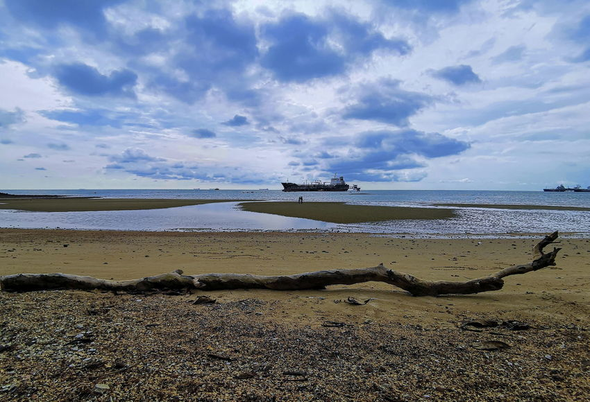 Beautiful blue sky with ship cargo at the sea Sky Water Beach Sea Cloud - Sky Land Scenics - Nature Beauty In Nature Sand Nautical Vessel Tranquility Tranquil Scene Horizon Horizon Over Water Nature Day No People Non-urban Scene Outdoors