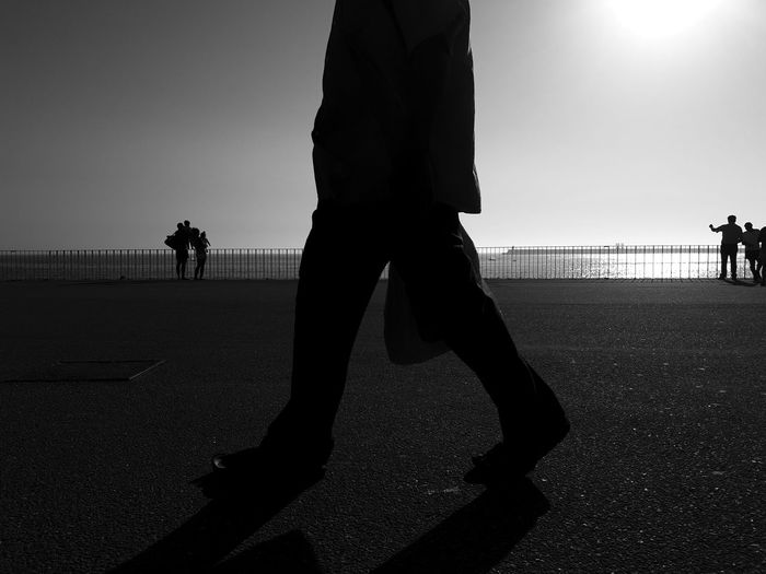 Porto beach. Oporto Portugal Shapes Sunlight Walking Around Black And White Blackandwhite Blackandwhite Photography Bnw City Full Length Horizon Over Water Leisure Activity Men Nature People Real People Shadow Silhouette Sky Street Streetphoto_bw Streetphotography Sunlight Walking The Street Photographer - 2018 EyeEm Awards The Traveler - 2018 EyeEm Awards