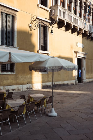 Absence Architecture Arrangement Building Building Exterior Built Structure Cafe Chair City Day Empty Nature No People Outdoors Residential District Restaurant Seat Setting Sidewalk Cafe Street Table Venice