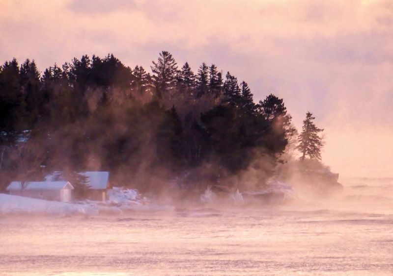 Morning sea fog on Superior Tree Nature No People Cold Temperature Outdoors Winter Beauty In Nature Sky Sunset Snow Scenics Water Day Mountain Lake Superior Minnesota Beauty In Nature Malephotographerofthemonth Weather Travel Destinations Winter EyeEm Best Shots
