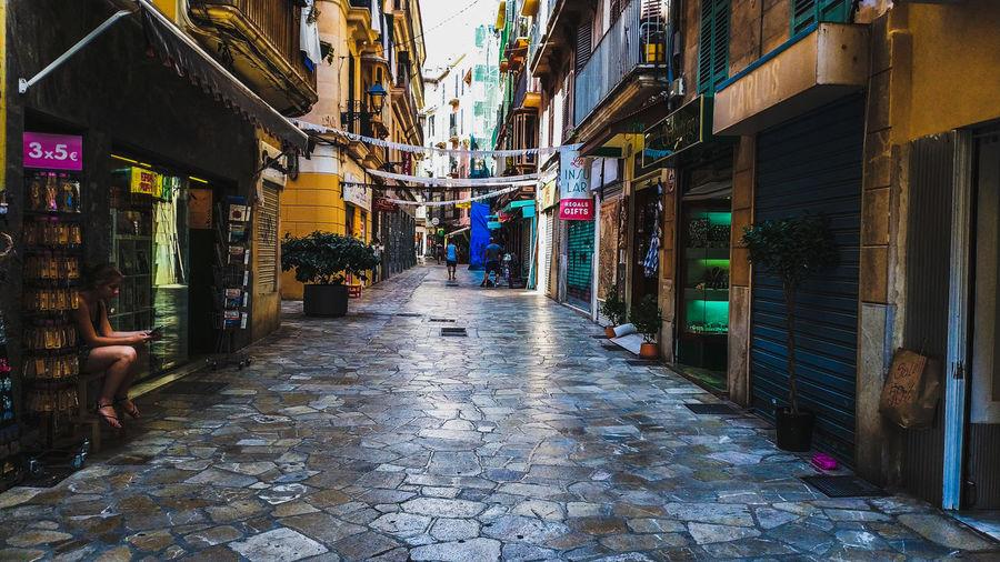 Narrow street amidst buildings in city