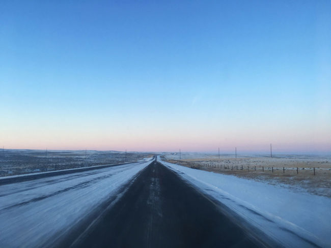 Highway 59 near Douglas, Wyoming after a recent snow in December, 2017 Wyoming Blue Clear Sky Cold Temperature Day Diminishing Perspective Landscape Nature No People Outdoors Prairie Road Scenics Sky Snow Straight The Way Forward Tranquil Scene Transportation Winter
