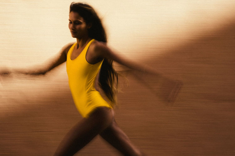 Blurred motion of woman running