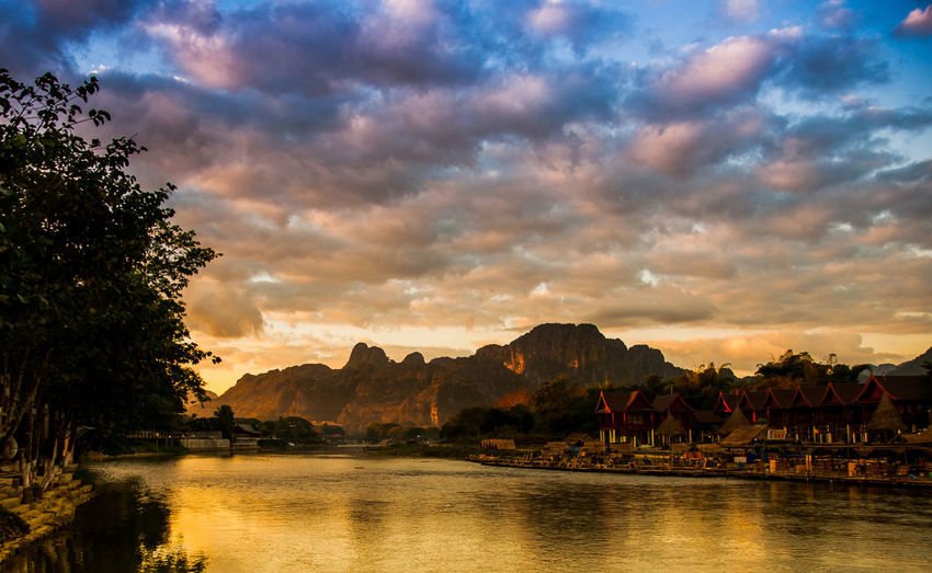 Living on both sides of the river in front of mountains in the morning light and cloud cover. Bank Beauty In Nature Cloud - Sky Cloudy Day House Mist Morning Light Mountain Nature No People Outdoors River Scenics Sierra Sky Sunrise Sunset Tranquil Scene Tranquility Tree Water Water Bun Waterfront Living