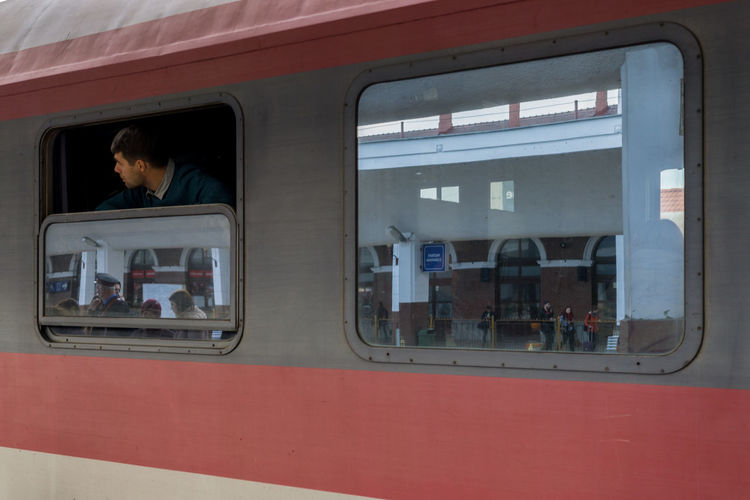Window Mode Of Transportation Transportation Public Transportation Train Travel Rail Transportation Train - Vehicle Incidental People Glass - Material Reflection Transparent Day Land Vehicle Group Of People People Sitting Red Architecture Outdoors