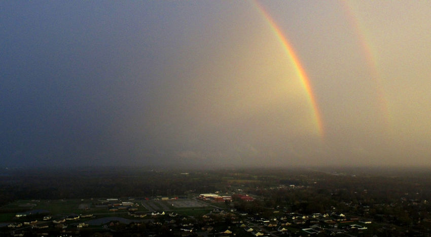 A double rainbow emerges from a cloud over Carterville, Illinois. Drone  Aerial Aerial View Beauty In Nature City Cityscape Day Dji Double Rainbow Nature No People Outdoors Rainbow Rainbow🌈 Scenics Sky Spectrum