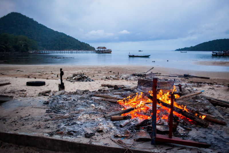 Beach Beauty In Nature Burning Day Flame Heat - Temperature Mountain Nature No People Outdoors Scenics Sea Sky Tranquility Water
