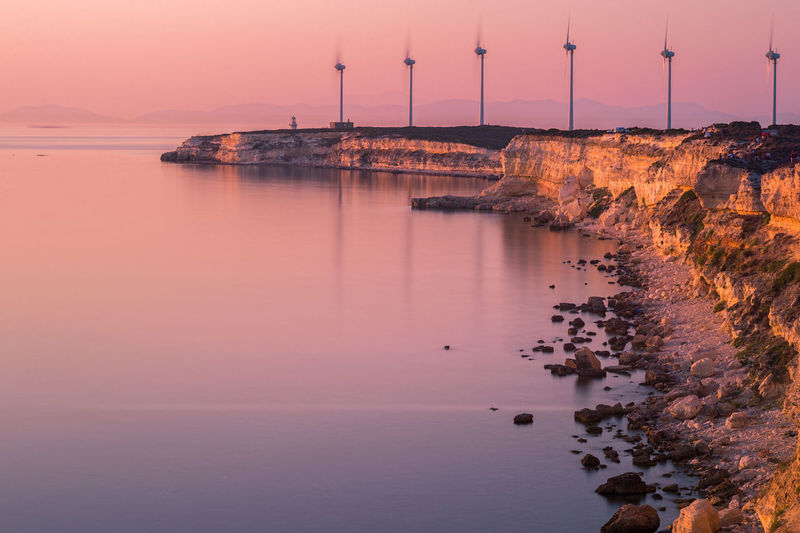 Wind Turbines of Tenedos / Bozcaada. Long exposure Bozcaada Calm Energy Island Islandlife Landscape Landscape_Collection Landscape_photography Long Exposure Natanomalous.com Peaceful Sea Sea And Sky Seascape Seaside Seaview Sunset Nature's Diversities The Great Outdoors - 2016 EyeEm Awards Alternative Energy Sunset_collection My Favorite Photo Turkey Landscapes With WhiteWall Wind Turbine My Year My View
