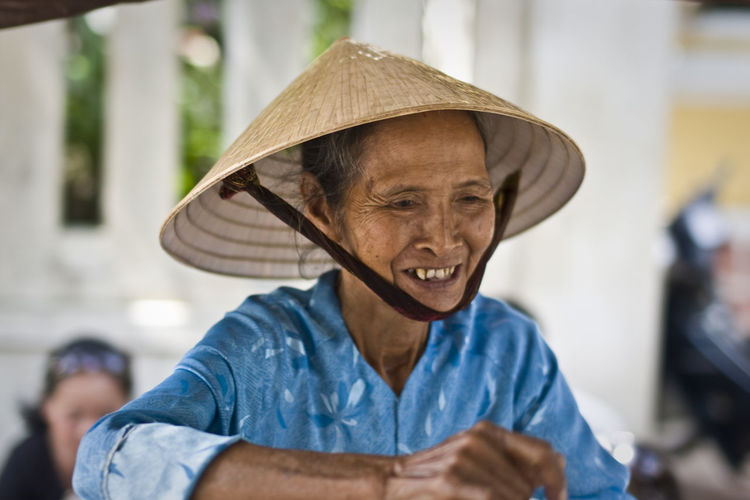 ASIA Blue Check This Out Chinamanshat Chinese Hat EyeEm Best Shots Front View Hanging Out Happiness Hat Head And Shoulders Headshot Huế Looking At Camera Non La Person Portrait Portrait Of A Woman Real People Smiling Streetphotography Vietnam Vietnamese