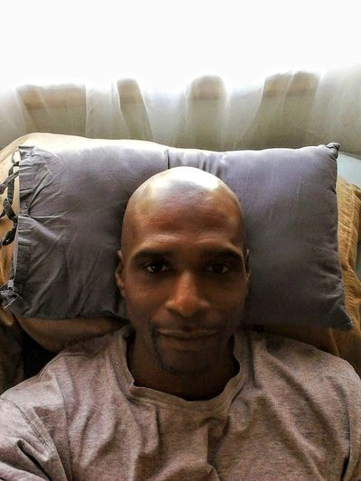 Digital Media Graphic Designer Professional Photography Center City Philadelphia Pa. Portrait Men Looking At Camera Relaxation Headshot Shaved Head Comfortable Front View Completely Bald Cozy Home Sweet Home Napping