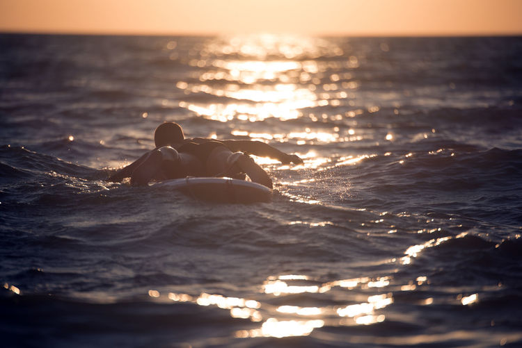 Sirf Beauty In Nature Day Horizon Over Water Leisure Activity Lifestyles Nature One Person Outdoors People Real People Scenics Sea Sky Sunlight Sunset Sup Swimming Tranquil Scene Tranquility Vacations Water Waterfront Wave Young Adult