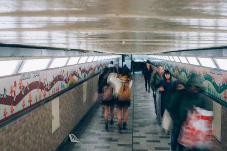 Subway Subway Station Subway Platform Underground Underground Walkway Shootermag Lifestyles Group Of People Architecture Real People Transportation Public Transportation Indoors  Walking Motion Women Adult People Steps And Staircases Blurred Motion Men Staircase Rear View