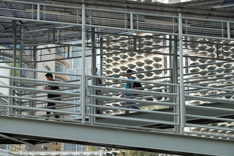 Stairs to Jakarta busway Architecture Metal Staircase Walking Standing Steps And Staircases Railing Travel People