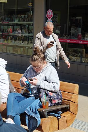The Street Photographer - 2017 EyeEm Awards Streetphotography Street Photography Adult Mobile Phone Mobile Love Engrossed Chester Cheshire Street Different Worlds Young And Old Young Woman Man Walking