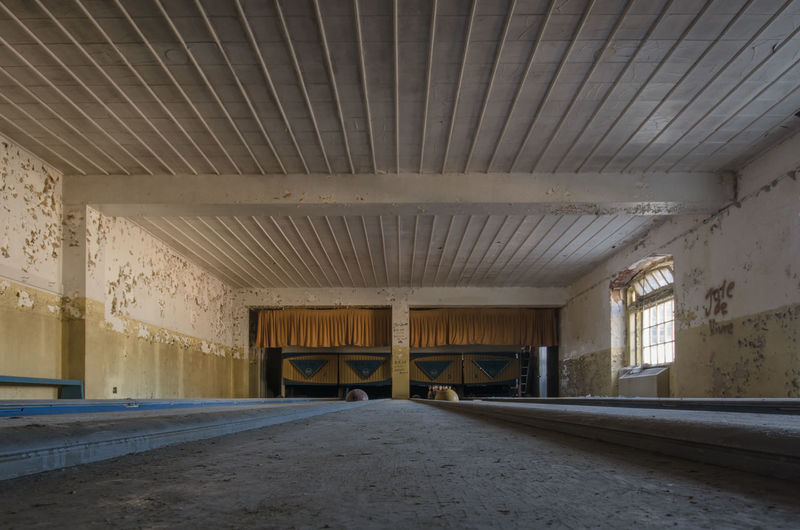 Abandoned Absence Architectural Column Architecture Asylum Bowling Bowling Alley Built Structure Ceiling Column Corridor Day Diminishing Perspective Empty Flooring Illuminated Interior No People The Way Forward Urbex