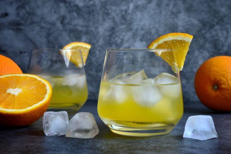 Close-up of orange juice on table