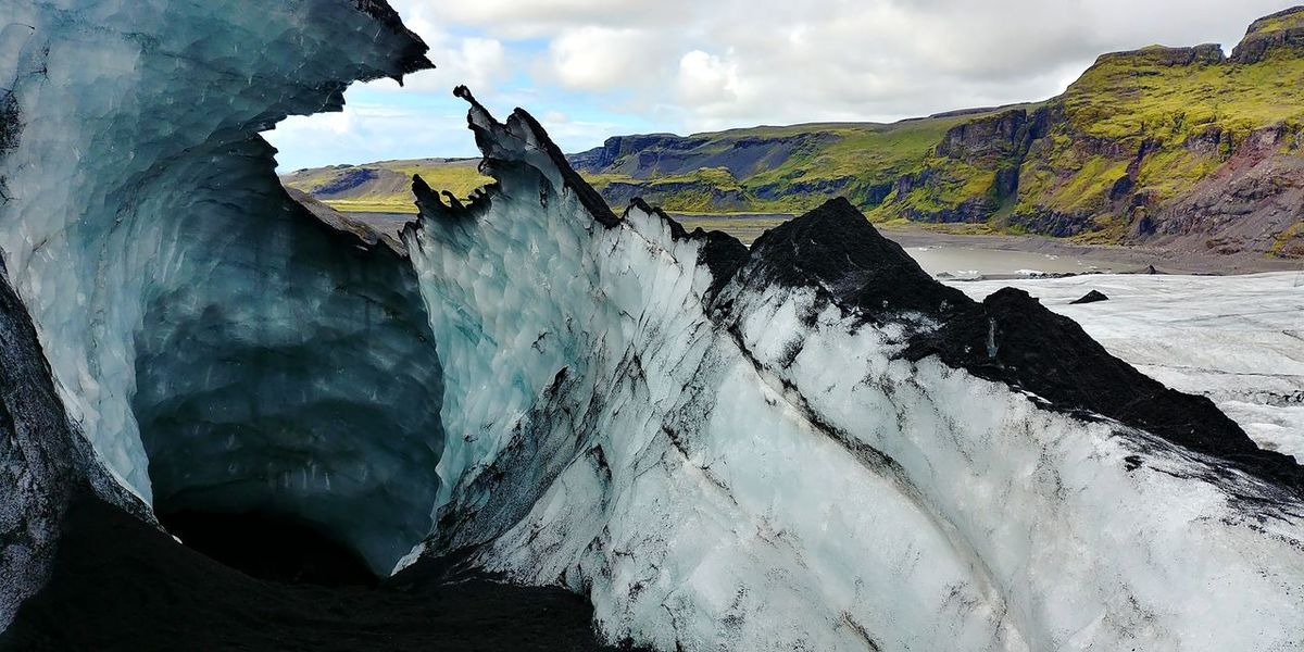 Cloud - Sky Rock - Object Outdoors Sky Mountain Water Day Nature Landscape Cliff No People Beauty In Nature Breathing Space Power In Nature Sand Lava Volcanic Landscape Glacier Vacations Iceland_collection Iceland Cold Temperature Planet Earth Beauty In Nature Nature