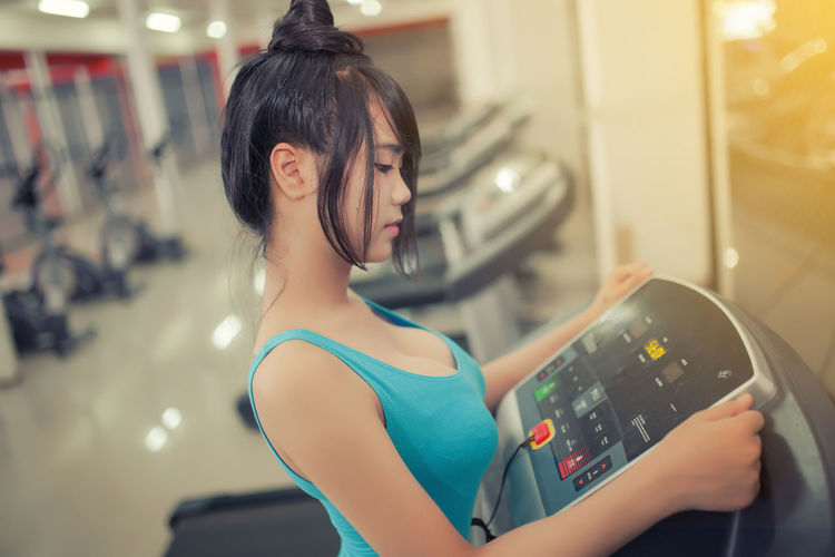High angle view of woman on treadmill