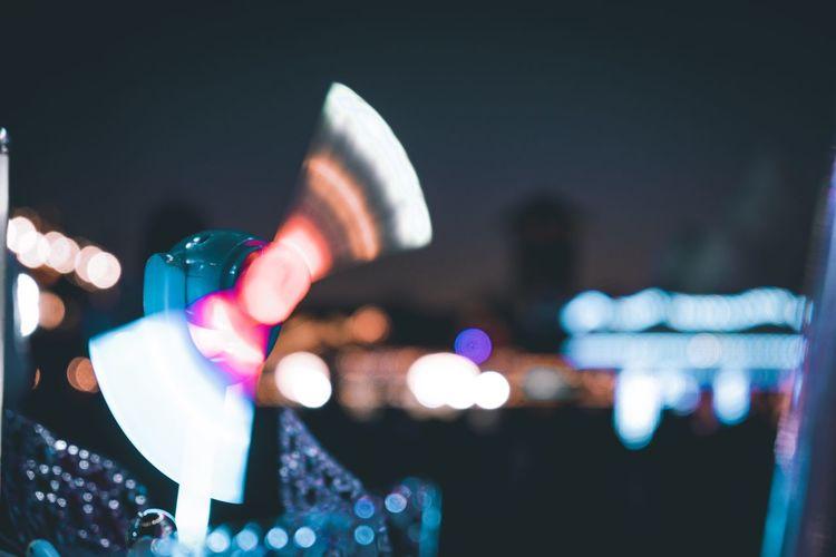 Blurred motion of illuminated multi colored pinwheel toy at night