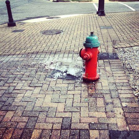 let it flow. Cobblestone Day Fire Hydrant No People Outdoors Red Sidewalk Stone Tile Street Water The Street Photographer The Street Photographer - 2017 EyeEm Awards Neighborhood Map