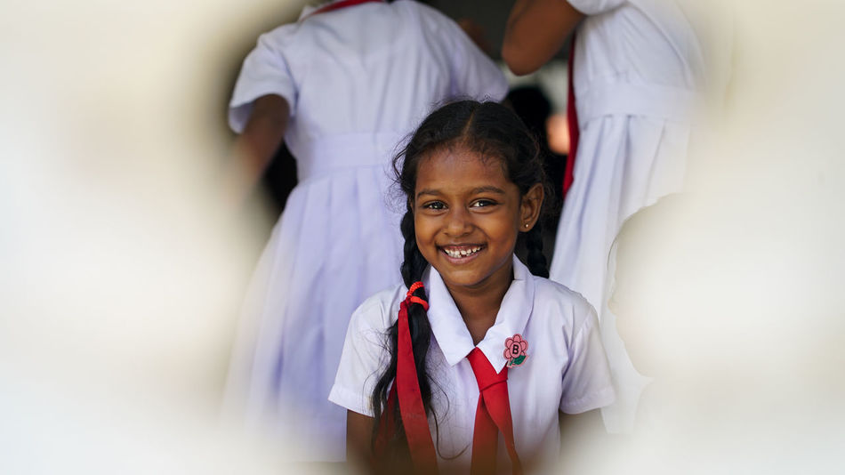 Caught a schoolgirl during her break while walking the streets with Katharina. When she noticed us she began to pose. SchoolGirl Sri Lanka Cheerful Childhood Day Elementary Age Friendly Friendly Smile Girl Happiness Indoors  Looking At Camera Portrait Posing Real People Red Tie School Uniform Schoolgirls Smile Smiling Standing Travelphotography Two People Vacation White Clothes Connected By Travel