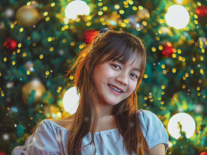 Portrait of happy girl in tree during christmas