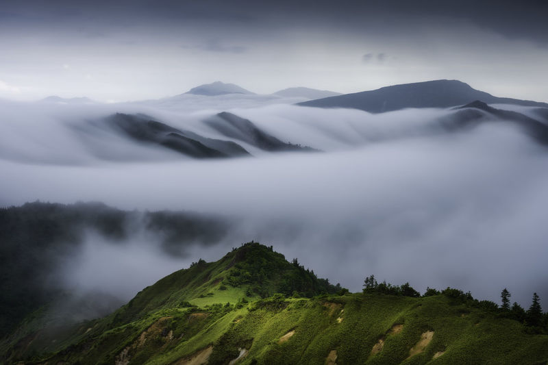Scenic view of mountains in foggy weather