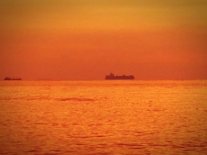 sunset offshore with cargo ships Dawn Dusk Sky Sunset Silhouettes Sunsets Minimalism Minimal Minimalobsession Less Is More Minimalist Beach Photography Outdoors Transportation Water Horizon Over Water Offshore Platform Nature Scenics Harbor Oil Industry Sky Sailing Ship Day Oil Pump