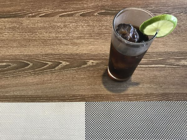 Coke Mat Alcohol Close-up Coca Cola Day Drink Drinking Glass Food Food And Drink Freshness Grey Color Healthy Eating Iced Indoors  Lime No People Place Mat Refreshment Sliced Table White Wood - Material
