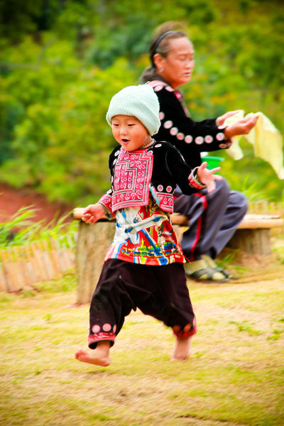 Tribal children in Thailand Romp merrily and happily in his village in the mountains. At Mon-Jam Chaingmai Thailand. First Eyeem Photo Amazing People Travel Fun Colorful Outdoor Smile Thailand Weather Countryside Life Lifestyle Nature Portrait Relax Environment Enjoy Season  Grass Tree Children Two Monjam Chaingmai