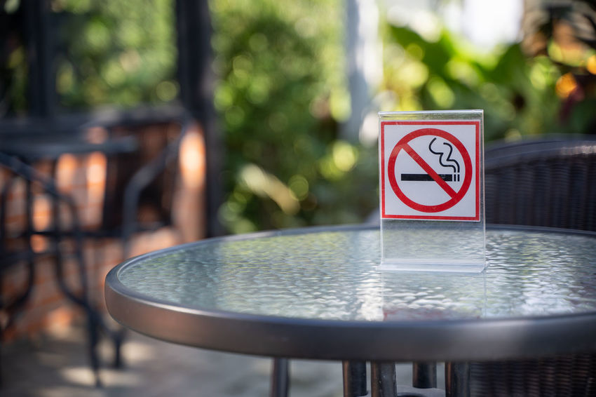 Sign No People Communication Focus On Foreground Day Table Close-up Warning Sign Selective Focus Forbidden Cigarette  No Smoking Sign Outdoors Shape Nature Metal Information Representation Smoking Issues Railing Silver Colored
