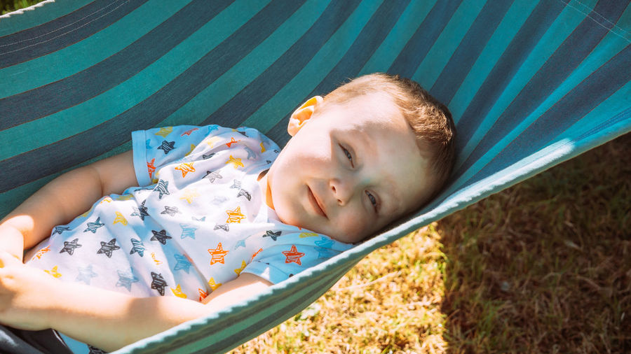 High angle portrait of cute boy lying on floor