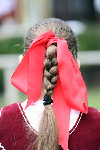 Red Ribbon Tied On Braided Hair
