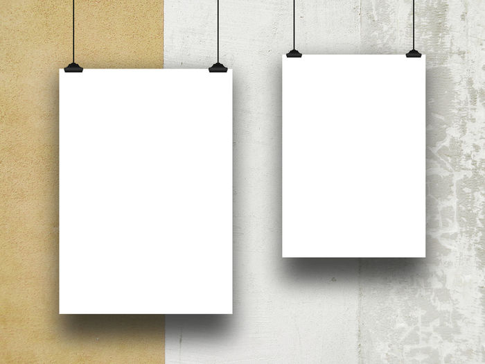 Close-Up Of Blank Papers Hanging On Wall
