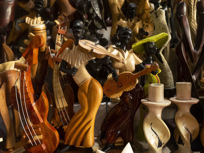 Close-up of statues for sale at market