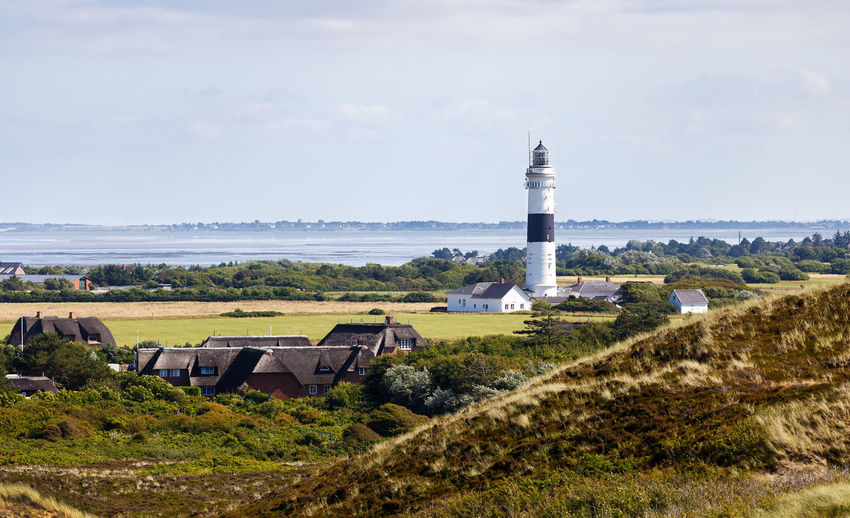 """The """"Lange Christian"""" as seen from the """"Uwe-Düne"""" - Sylt, Germany Kampen, Germany Sylt, Germany Architecture Beach Beauty In Nature Building Exterior Built Structure Day Grass Lighthouse Nature No People Outdoors Scenics Sea Sky Water Lighthouse, Sylt"""