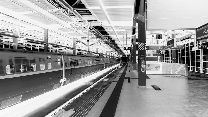 Black & white shot of bullet train arriving in station. Built Structure Bullet Train City City Life Diminishing Perspective Japan Modern Shinkansen The Way Forward Train Train Station Traveling