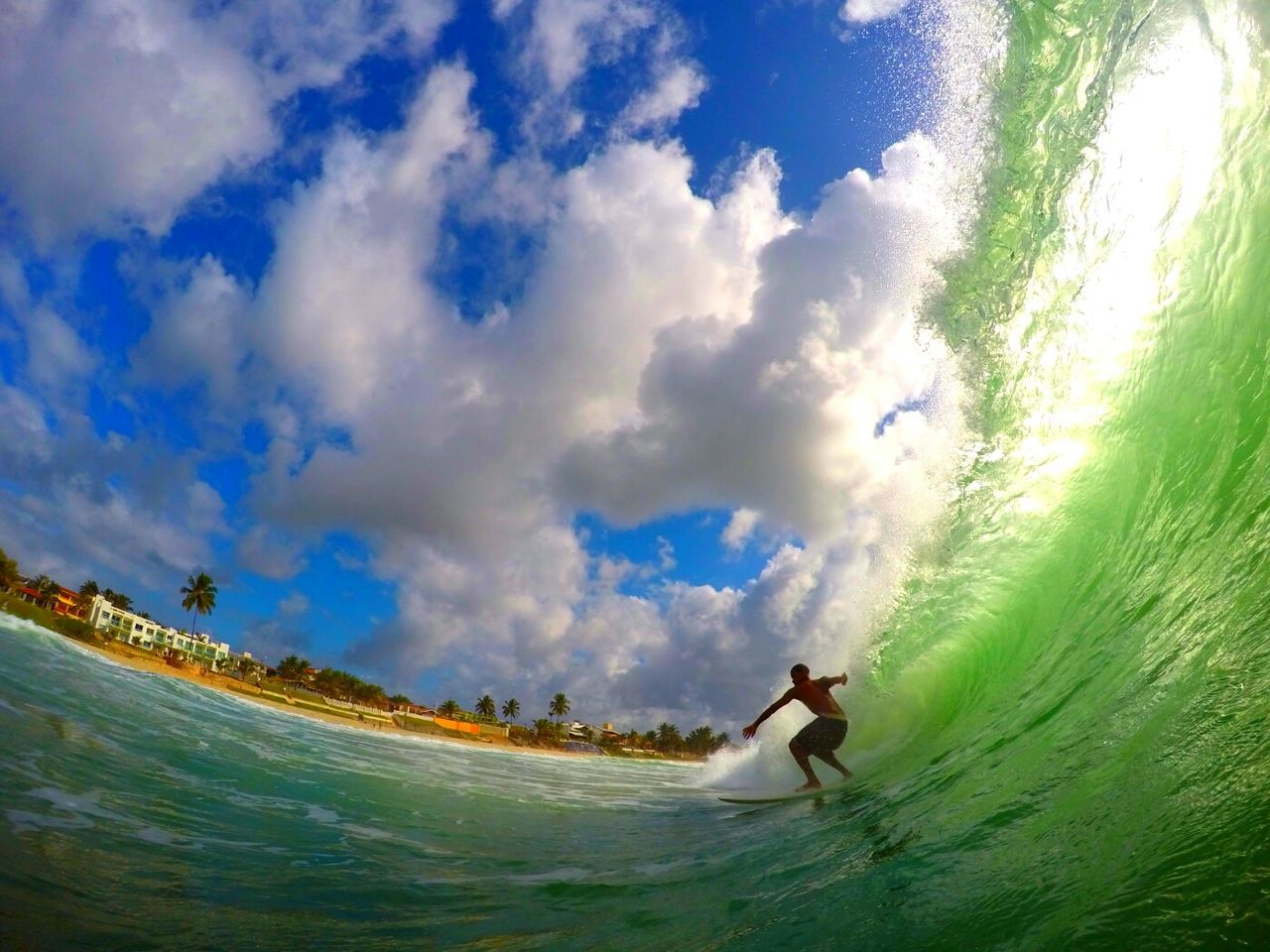 water, real people, cloud - sky, sky, leisure activity, sea, one person, vacations, outdoors, beach, surfing, nature, day, lifestyles, men, wave, adventure, motion, full length, fish-eye lens, horizon over water, extreme sports, beauty in nature, people