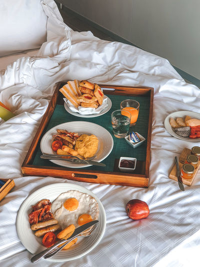 Breakfast on Bed Breakfast Omlette Hotel Room Textile Plate Crumpled Paper Close-up Served Pastry Dessert Waffle Salmon Pie Indulgence Prepared Food