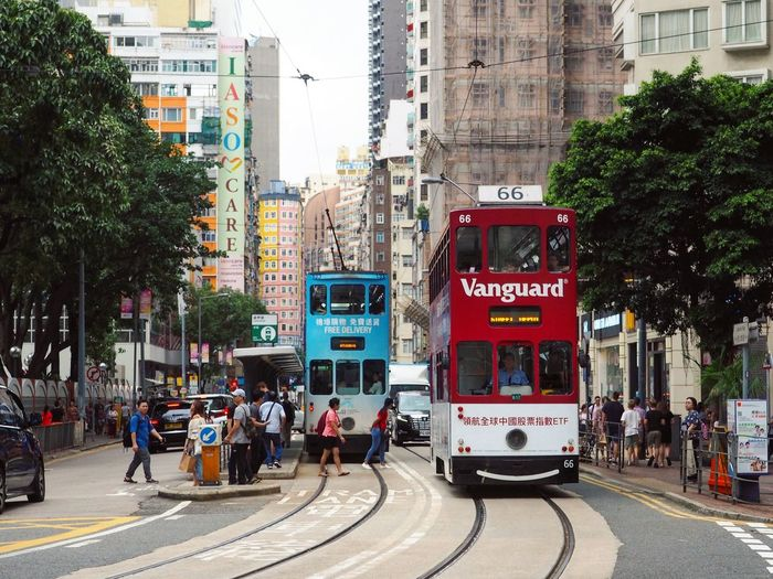 Cloudy City Across The Road Hong Kong Tram Tram Life In Hong Kong Hong Kong Architecture City Transportation Street Mode Of Transportation Road Building City Life Tree Real People City Street