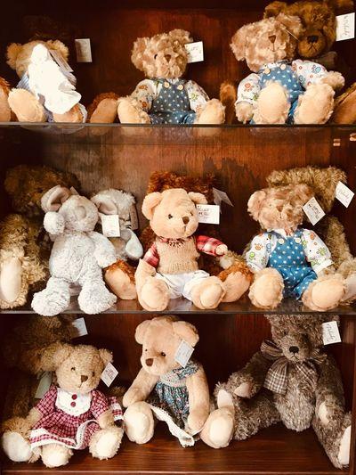 Stuffed toys on shelf