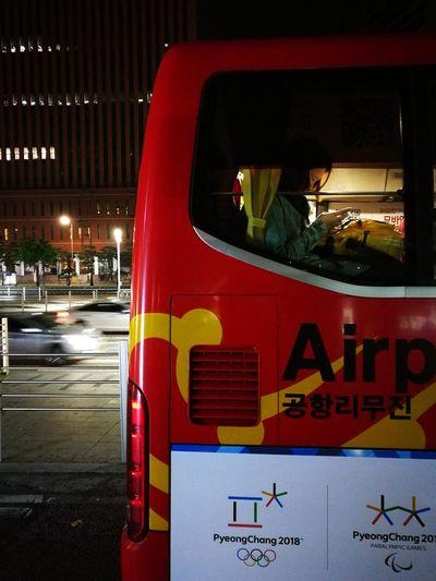 Illuminated text on bus at night