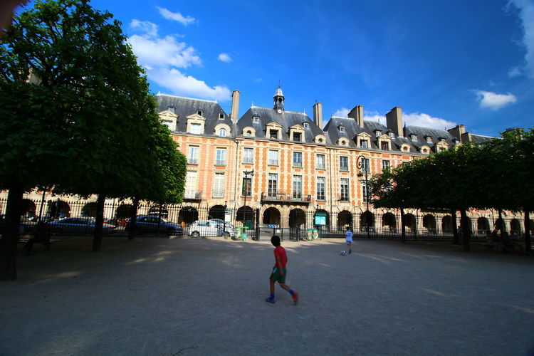 Children Architecture Building Exterior Built Structure Cloud - Sky Day Façade Full Length History Incidental People Large Group Of People Outdoors People Place Des Vosges Real People Sky Travel Destinations Tree