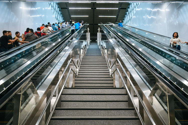 #Places #Train #escalator #interiors #people #subway #symmetry Adult Convenience Indoors  Large Group Of People Lifestyles Men Railing Steps