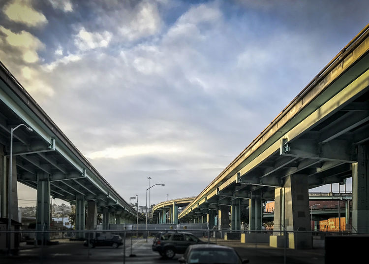 converging overpass Architecture Bridge - Man Made Structure Built Structure Car City Cloud - Sky Day Land Vehicle Low Angle View Mode Of Transport No People Outdoors Sky Transportation