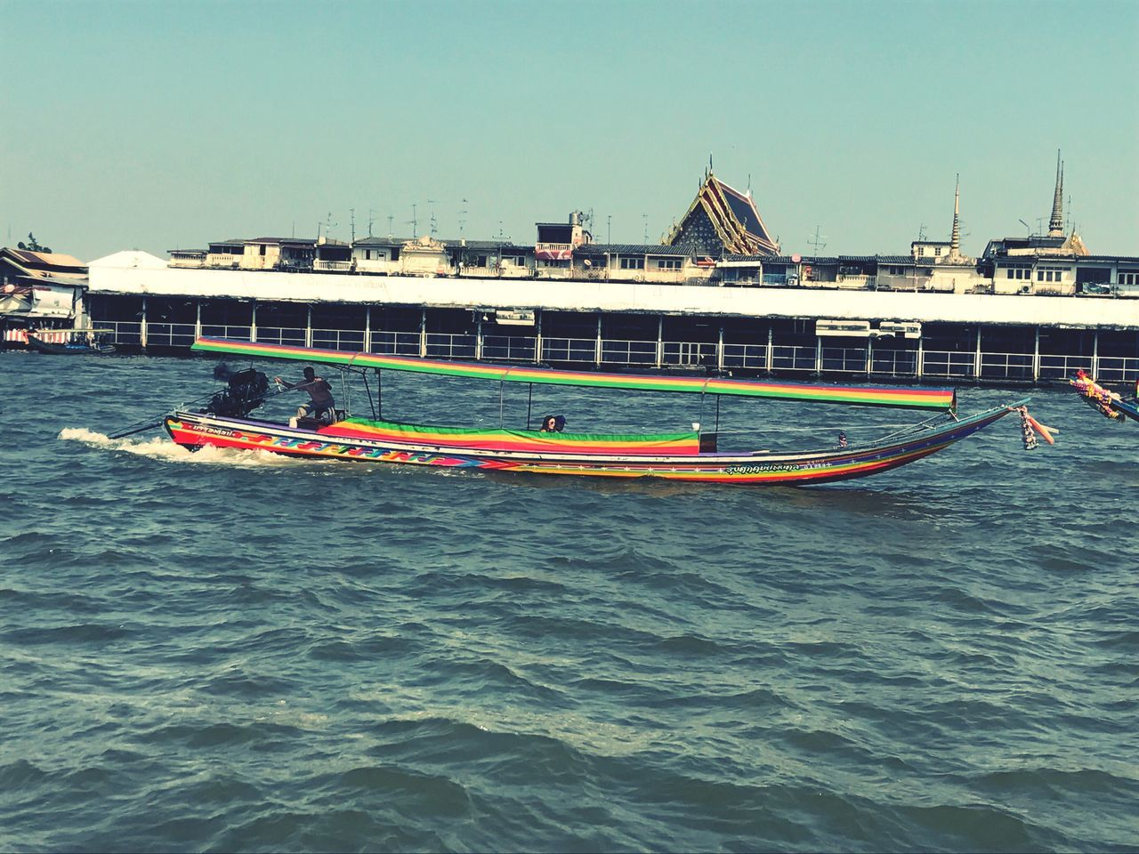 transportation, nautical vessel, mode of transport, water, day, waterfront, built structure, real people, outdoors, architecture, building exterior, clear sky, nature