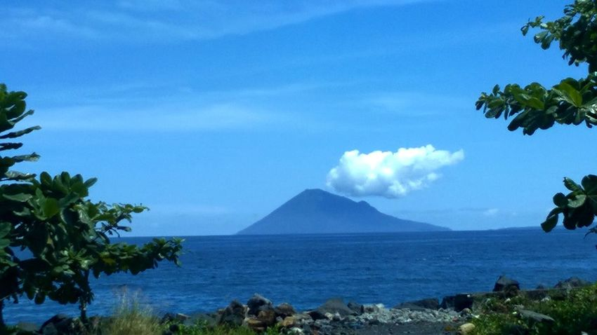 Over the sea Gunung Beach Beauty In Nature Blue Cloud Cloud - Sky Coastline Horizon Over Water Manado Mountain Mountain View Mountain_collection Mountains And Sky Nature Non Urban Scene Outdoors Scenics Sea Sky Tranquil Scene Tranquility Tree Water